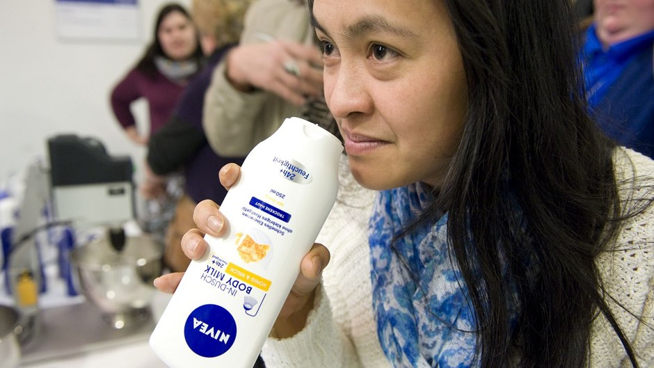 test subject smelling a NIVEA product