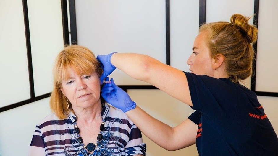Woman's ear being checked